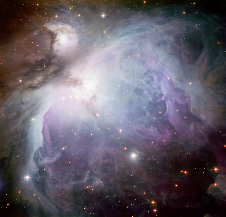 This new image of the Orion Nebula was captured using the Wide Field Imager camera on the MPG/ESO 2.2-metre telescope at the La Silla Observatory, Chile. This image is a composite of several exposures taken through a total of five different filters. Light that passed through a red filter, as well as light from a filter that shows the glowing hydrogen gas, is coloured red. Light in the yellow–green part of the spectrum is coloured green, blue light is coloured blue and light that passed through an ultraviolet filter has been coloured purple. The exposure times were about 52 minutes through each filter.